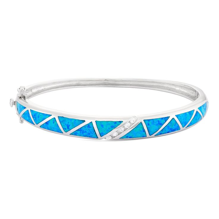 Sterling Silver Created Blue Opal & CZ Bangle. This bangle bracelet is inlaid with created blue opal for a unique look. The sterling silver bracelet has a high polish finish, and secures with a safety lock. Inspired by the Caribbean ocean, the stunning blue and green colors make it a perfect nautical accessory. You will adore this beach inspired Sterling Silver Opal Inlay Bracelet. In the Middle Ages, Opal was considered a stone that could provide great luck because it was believed to...