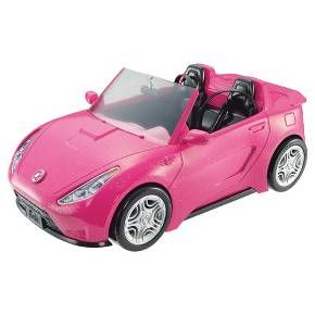 """Barbie doll can hit the road in style with this super glam convertible! Designed with an open roof, this pink two-seater is ready for an open road adventure -- or a quick trip to the store. Its sparkly pink exterior features tires with realistic styling and Barbie accents. Black interior seats make a statement with seat belts for realism and Barbie """"upholstery"""" labels for style. Hop in to drive into imagination and off into adventure. With this cool car, Barbie doll (dolls..."""