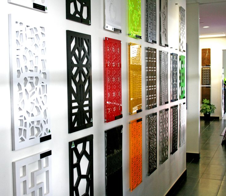 An array of sample sized screens in a variety of materials and designs line the wall of the QAQ Decorative Screens and Panels headquarters, Melbourne.