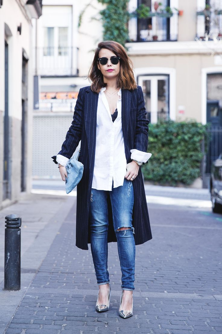 Sarah Escuadero of Collage Vintage wears a pinstripe coat with her jeans and simple blouse. Wear this to go grab cocktails. // Modern Ways To Wear The Vertical Stripe (You Already Own)