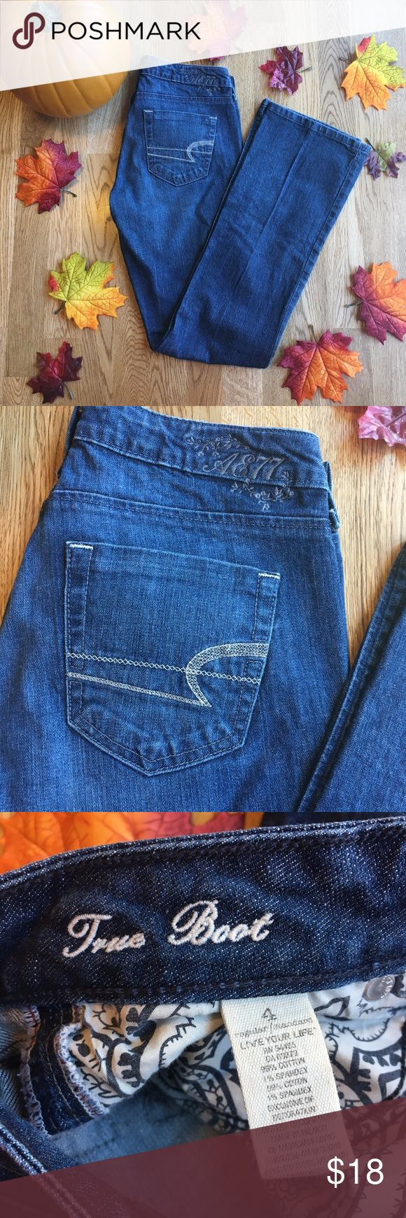 "American Eagle AE 77 True Boot Jeans EUC! Shiny silver stitching on back pockets and really pretty AE 77 embroidered on the back. No holes or stains. Please see the measurements in last photo! They are size 4 but waist is about 28"". I can sometimes wear a size 4 in AE (the stretchier jeans) but I cannot even get these on! Also the inseam is shorter than some jeans at about 30.5"". Please feel free to ask any questions so you can be confident in your purchase! These jeans are no longer listed…"