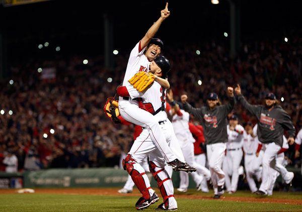 Pitcher Koji Uehara celebrates after striking out Cardinals slugger Matt Carpenter to win the World Series.