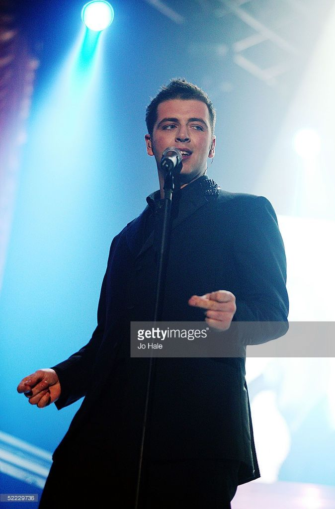 Mark Feehily of Westlife performs onstage during the first London date of their Number Ones tour promoting their sixth album, 'Allow Us To Be Frank,' a collection of Rat Pack swing covers at Wembley Arena Pavilion on February 22, 2005 in London.