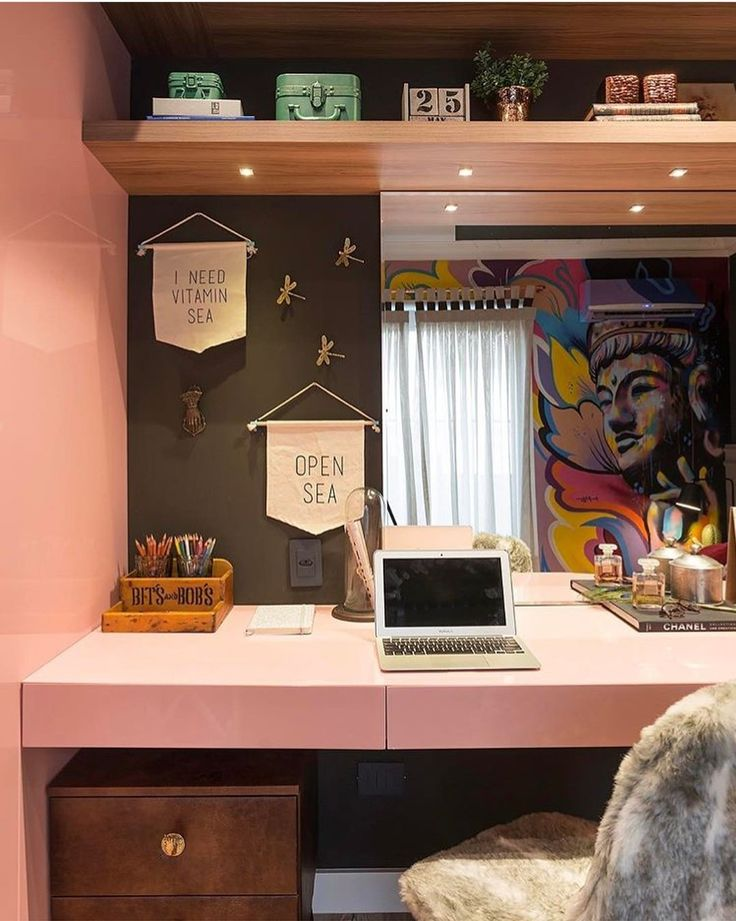 I like the bookshelf up above and the cool mural in the background... however, I would've picked a lighter color for the wall thing in the middle, just to open up the space. Also, a different dresser, probably in a lighter wood, and a more modern chair would improve this design.