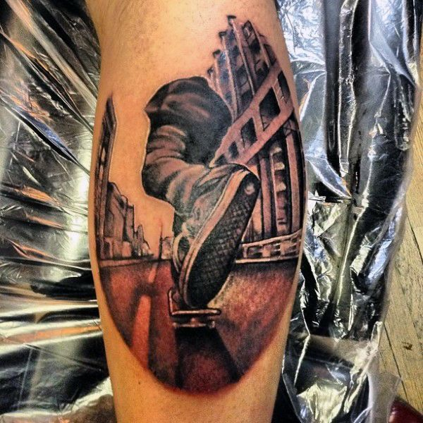 3d Man Riding Skateboard Tattoo On Leg Calf