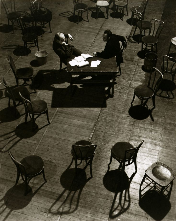 """Ralph Steiner: After rehearsal, 1936.    View from above of Morris Carnovsky, actor, and Lee Strasberg, director, discussing the play, """"The Case of Clyde Griffiths, a dramatization of Theodore Dreiser's An American Tragedy,"""" performed by the Group Theater at the Ethel Barrymore Theater, New York City."""