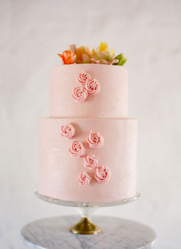 pretty pink wedding cake - photo by Jose Villa. Love the pink base color + flowers on top. Not fondant, real creamy frosting please.