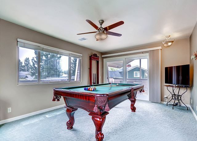 Upstairs Game Room with regulation pool table and HDTV.  Step out the door to the roof top deck.