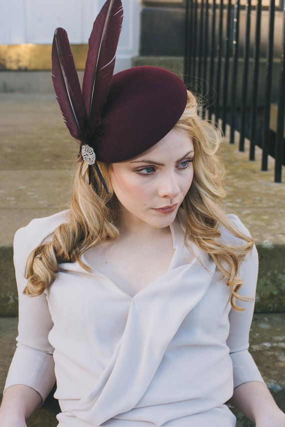 Elegant felt and feather percher hat for wedding guest or races.