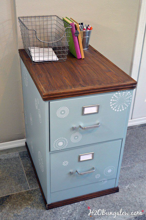 You know all of those old filing cabinets in the Thrift Shop…the ones that look like they have held tax returns for the last 78 years!!! Well this great DIY for a Wood Trimmed Filing Cabinet Makeover is going to inspire you to dust that filing cabinet off…clean it up…paint it and get to it!!! …