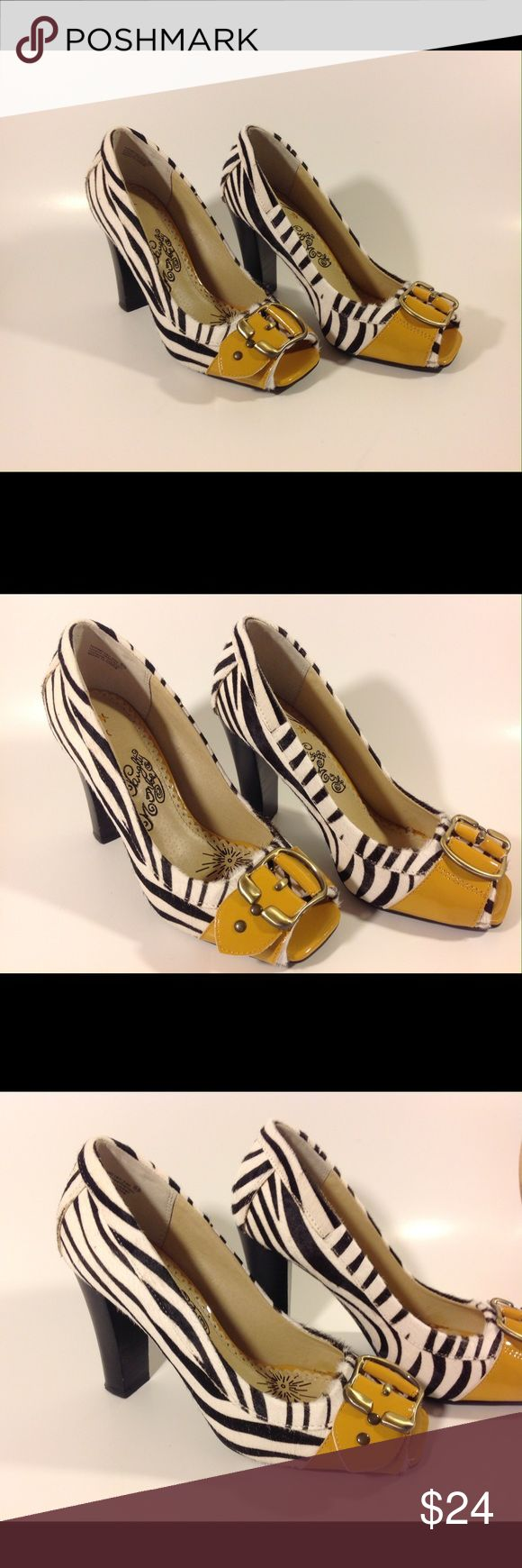 Naughty Monkey Funky Zebra Heels Too Cute Super cute naughty monkey zebra print heels.  These unique little shoes are in barely worn condition. naughty monkey Shoes Flats & Loafers