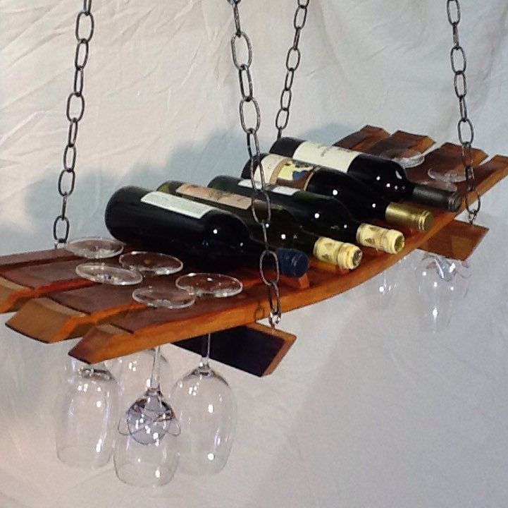 New Listing with Verona Wine and Design.  Our hanging wine rack can hold up to 7 wine bottles and 18 stemmed wine glasses.