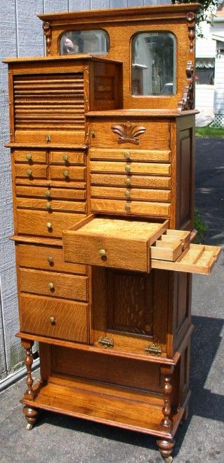 Tall oak dental cabinet.