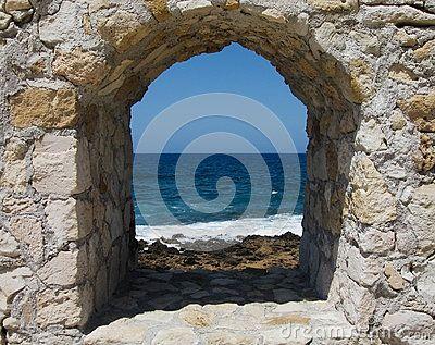Window overlooking the rough sea