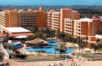 Puerto Rico; Embassy Suites Dorado del Mar - Beach & Golf Resort; NOT all-inclusive; 3.5 stars (4.5/5 on traveler reviews); $2300 from CID on Travelocity