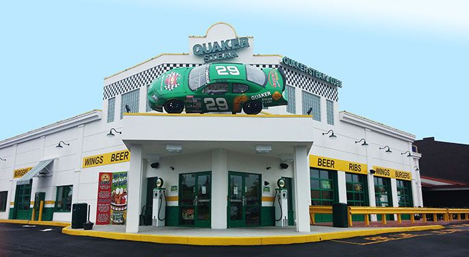 Quaker Steak & Lube® - York, PA with more than 23 different wing sauces, and the unique décor includes gas station memorabilia, classic cars, motorcycles, race cars and corvettes suspended from the ceilings.