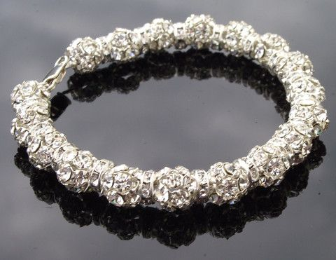 Joy Silver Crystal Encrusted Bracelet €88/$120  http://www.julesbridaljewellery.com/collections/wedding-bracelets/products/perfect-bridal-crystal-bracelet-swarovski-crystal-encrusted-bracelet-joy