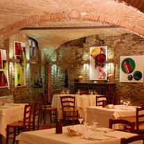 RISTORANTE ENOTECA DI CANELLI   The Enoteca Restaurant is located in one of the historic cellars in Canelli which have been nominated to become a Unesco World Heritage Site. It offers the typical cuisine of Piedmont and the local area, reworked in keeping with contemporary tastes. The premises also house a meeting and conference room, as well as art exhibitions and cultural events. The wines of more than 60 producer members are on sale in the Enoteca.