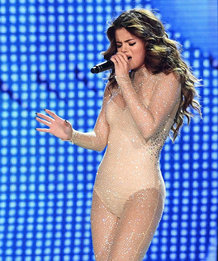 See All 5 of Selena Gomez's Dazzling Revival Tour Outfits from InStyle.com