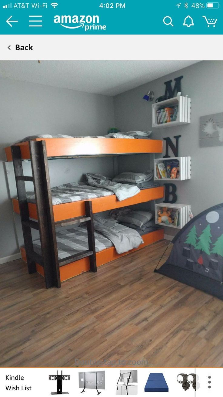 Triple bunk beds with crate nightstands attached to the wall
