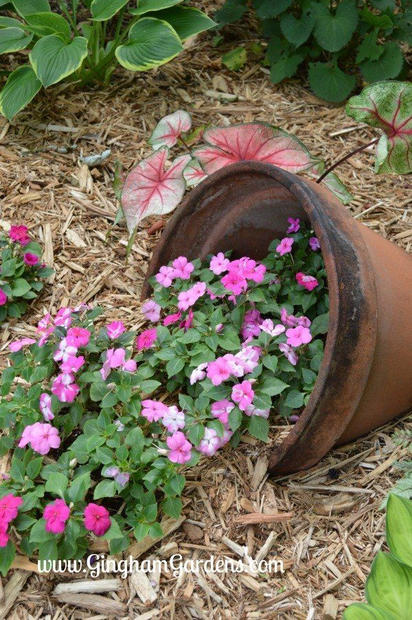 Add A Touch Of Creativity To Your Yard With A Spilled Planter Whimsical Garden Art Backyard Flowers Beds Whimsical Garden
