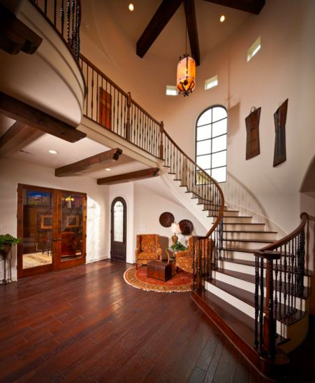 Curved stair case makes this entrance grand