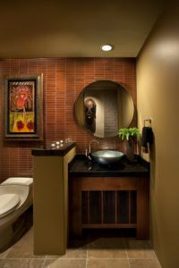This contemporary red and brown bathroom is perfect for the artistically- inclined.