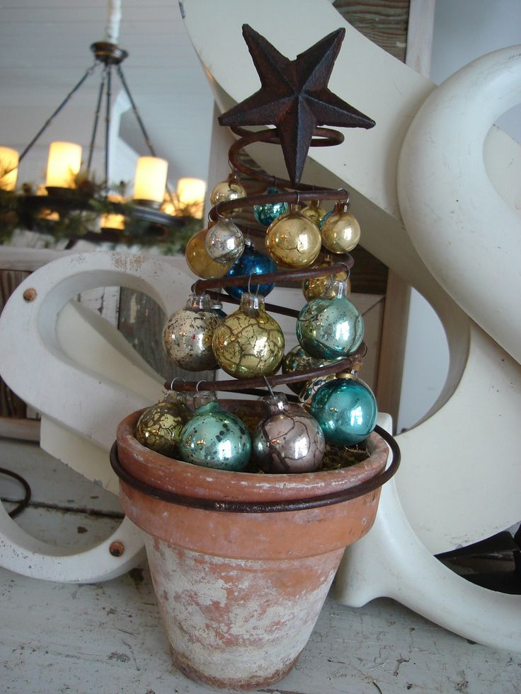 Ornament Tree from rusty spring - @Tamara Dunkin - you will love this site! Prepare to swoon. I can't find this exact image on her site, which is why I repinned, but there's LOTS of amazing vintage displays!