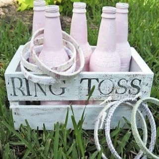 DIY ring toss with painted bottles and embroidered hoops wrapped in cloth and ribbon