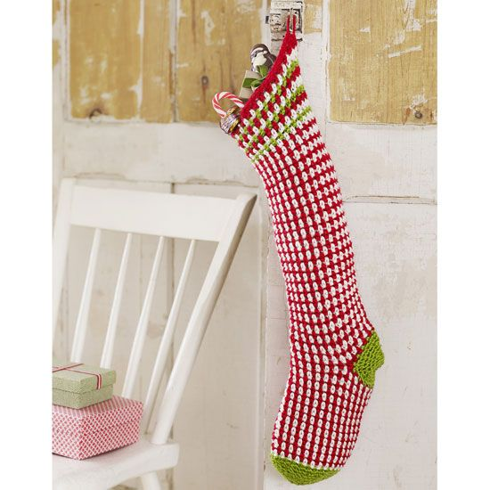 This easy crochet Christmas stocking uses single crochet and chain stitch to make a charming pinstripe pattern.data-pin-do=