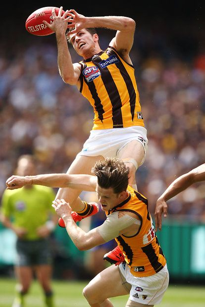 2015 Toyota AFL Grand Final - Hawthorn v West Coast - Isaac Smith of the Hawks marks the ball over teammate Taylor Duryea