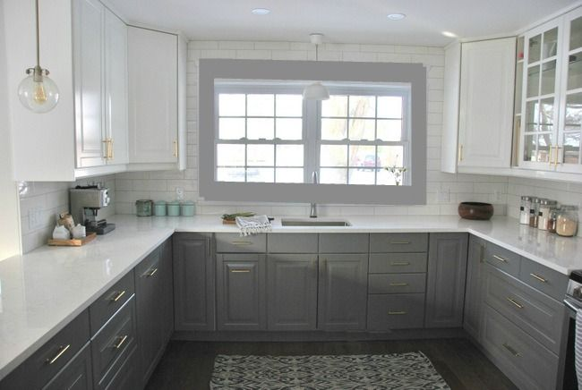 I love the use of the two toned cabinets.The brushed bronze handles and Edison bulb pendent lights add a fun and uplifting accent color to the kitchen. What a beautiful kitchen design.  -Side note I see in the photo the grey trim was photoshopped around the window. I'm not sure why it was. I however would like the photo better if it wasn't.-