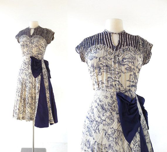 sold // 1940s Medieval City novelty print dress with dramatic side swag and neckline