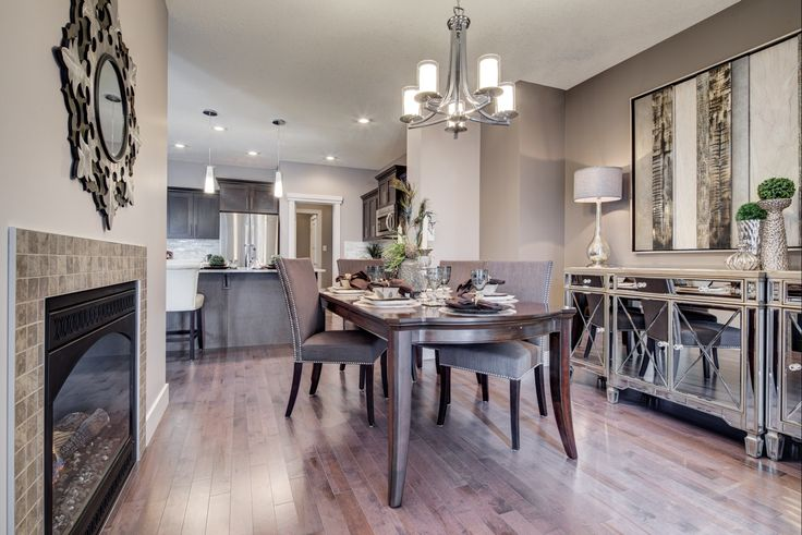 A dining room with a two-way #fireplace - fantastic! http://blog.yourpacesetter.com/blog/bid/335496/New-Show-Home-The-Kristana-in-Crystallina