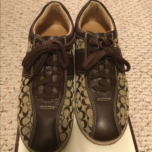 Coach tennis shoes Signature coach tennis shoe that's been slightly worn....like new....only wore a few times Coach Shoes Sneakers