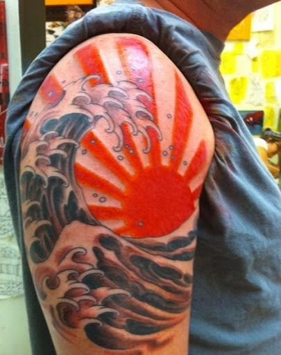This is a Japanese sun tattoo design in this tattoo see rising sun with rays .