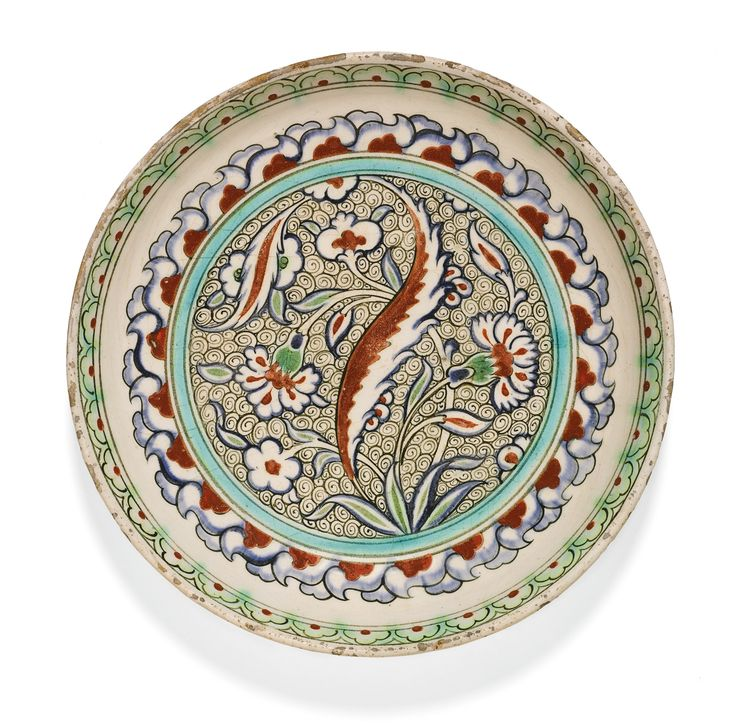 An Iznik polychrome pottery dish with a wave-scroll ground, Turkey, circa 1585-90 | Lot | Sotheby's