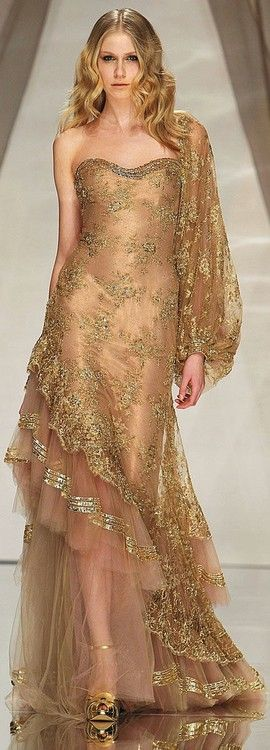 Sheer gold evening gown by Abed Mahfouz.