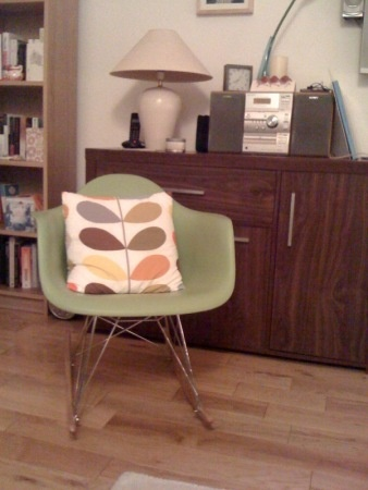 Eames RAR Rocker...purchased. Love the pillow with it.