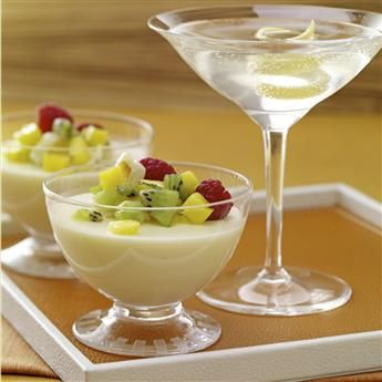 The floral flavor and citrus aromas of lychee and #lemongrass are paired in this panna cotta dessert, topped with tropical fruit salsa. #gourmet #recipes