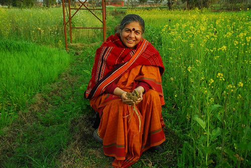 """Vandana Shiva is an environmental activist with a focus on agriculture and food. She is author of numerous books and hundreds of scientific papers. Dr. Shiva is founder of Navdanya International. An organization that aims to """"defend and protect nature and the rights of people to access to food and water and dignified jobs and livelihoods."""