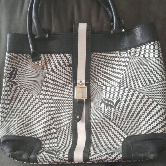 Large L.A.M.B. purse One of Gwen's first collection out. Has wear and tear as you can see in pictures. One strap needs repair. Inside is in great condition. Open to offers L.A.M.B. Bags Satchels