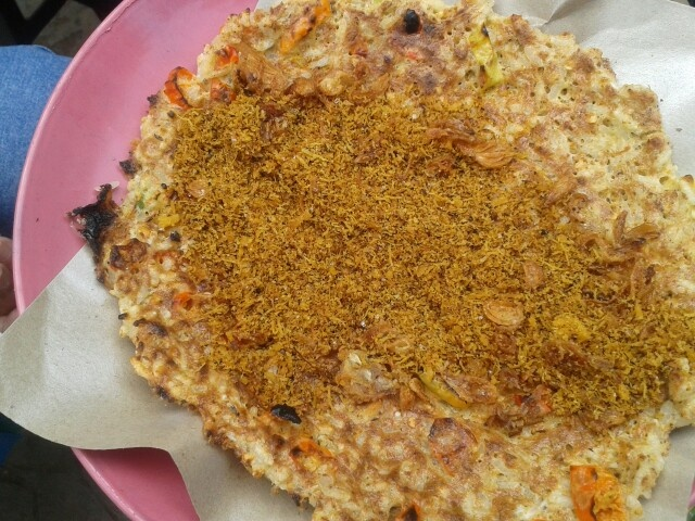 Kerak telor: Indonesia traditional food ....the specialty from betawi....jakarta's natives...made from eggs, sticky rice, coconut, fried red onions ....burn on firewood...hmmm...yummy