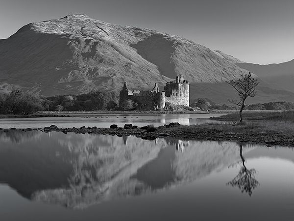 """Kilchurn Castle, Scotland Kilchurn Castle, or """"Fort of the Narrow Rock,"""" is sometimes blocked off by higher-than-usual water levels in Loch Awe, located in Argyll and Bute, Scotland."""