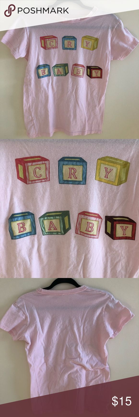"""👶🍼 CRYBABY MELANIE MARTINEZ PINK SHIRT A light pink shirt from Melanie Martinez's Cry Baby album. Says """"Cry Baby"""" in block letters. She is an artist I cannot enjoy anymore due to allegations, but if anyone is interested I am selling this shirt. Worn a few times but in good condition! Size tag ripped off but it is a Small. PRICE TOO HIGH? MAKE AN OFFER!! Hot Topic Tops Tees - Short Sleeve"""