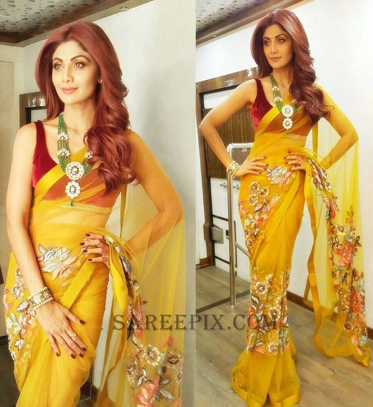 Shilpa shetty in yellow transparent saree designed by Manish Malhotra. She posted this pic on her Instagram profile. Curly hairstyle and sleeveless blouse