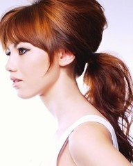 A+ for color, bangs and messy pony. Love color and style.