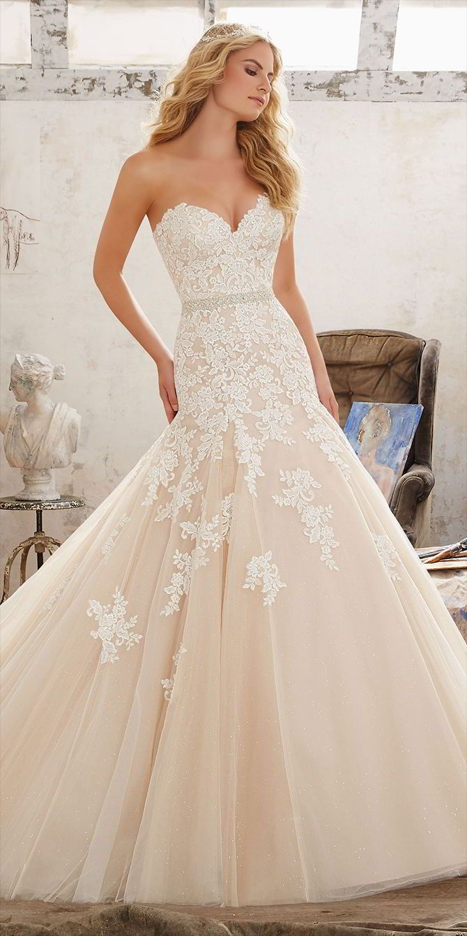 New 2017 Wedding Dress, it's a classic Fit & Flare Bridal Gown Featuring Sweetheart Neckline and Frosted, Embroidered Appliques on Tulle Over Sparkle Net. Covered Button Detail Along Back.