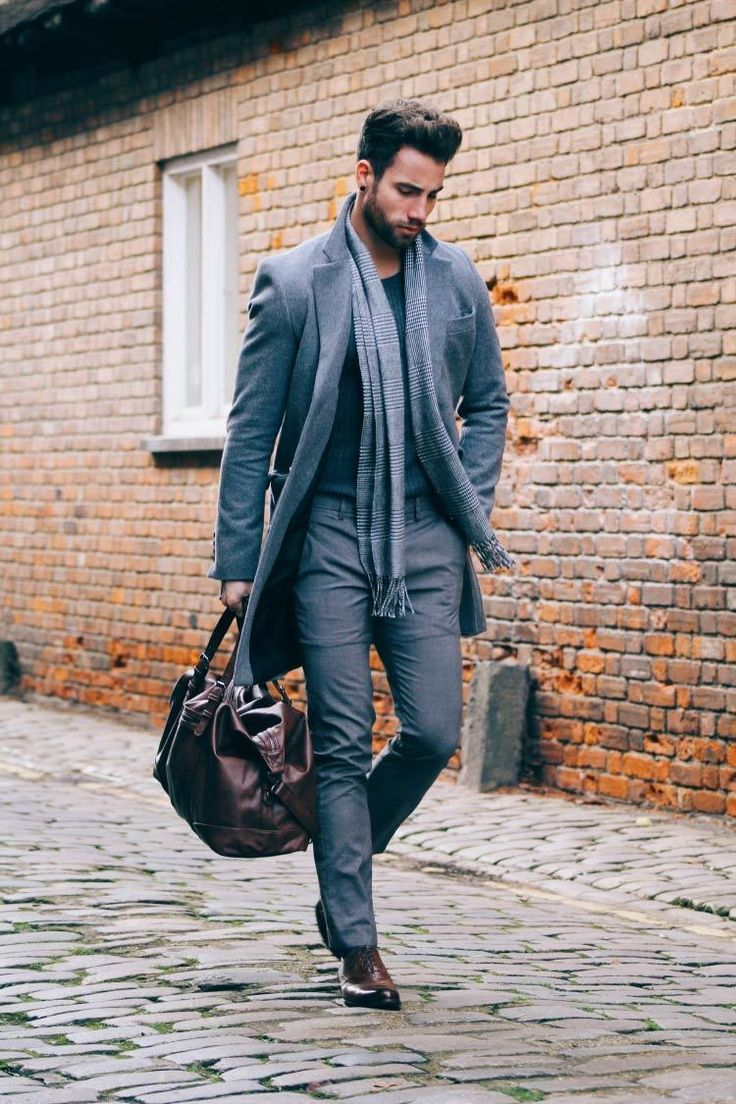 Consider teaming a grey overcoat with grey dress pants for a sharp classy look. A pair of dark brown leather oxford shoes will bring a strong and masculine feel to any ensemble.   Shop this look on Lookastic: https://lookastic.com/men/looks/overcoat-crew-neck-sweater-dress-pants/21291   — Grey Plaid Scarf  — Charcoal Crew-neck Sweater  — Grey Overcoat  — Grey Dress Pants  — Dark Brown Leather Holdall  — Dark Brown Leather Oxford Shoes