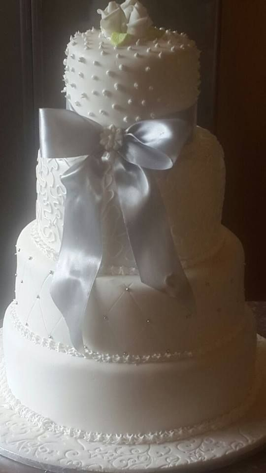 4 Tier white wedding cake with fine detail by Altefyn Cakes